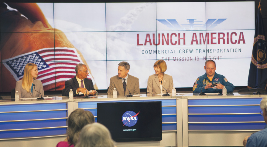 NASA Administrator Charles Bolden (left) speaks with Kennedy Space Center Director Bob Cabana and Kathy Lueders, manager of the agency's commercial crew program, before the CCtCap announcement. Astronaut Mike Fincke (right) also took part in the event. Credit: NASA/Jim Grossman