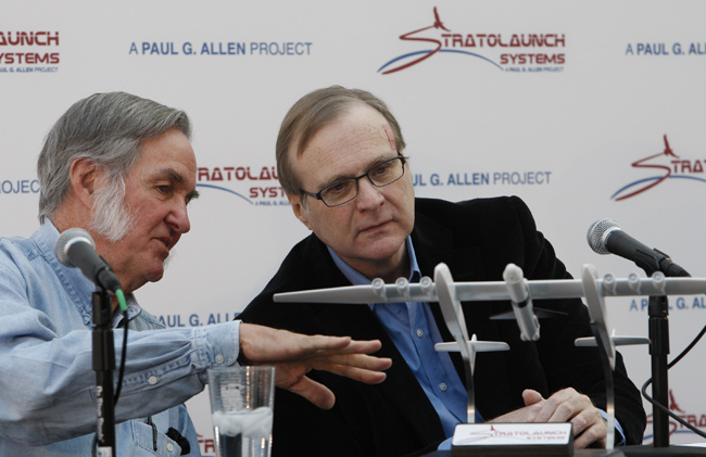 Microsoft co-founder Paul Allen, right, confers with airplane designer Burt Rutan during the 2011 unveiling of the Stratolaunch concept.