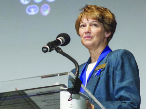 Eileen Collins, the first woman to pilot and command space shuttle missions speaks after being inducted into the Astronaut Hall of Fame. Credit: NASA/Kim Shiflett