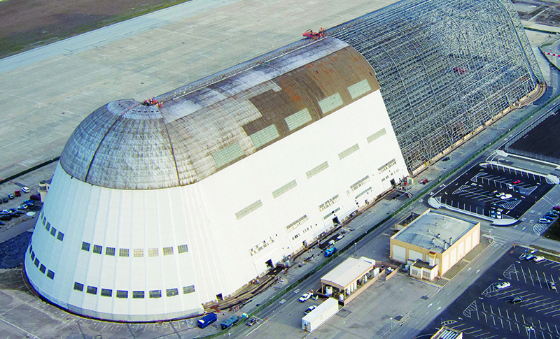 Moffett Federal Airfield's Hangar One, an enormous structure built to house airships in the 1930s, was torn down to its skeletal structure in 2012 because toxic chemicals from its roof and siding were polluting nearby air and groundwater. Credit: NASA