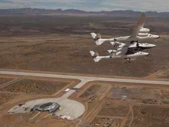 Virgin Galactic's WhiteKnightTwo/SpaceShipTwo flies over Spaceport America. Credit: Virgin Galactic