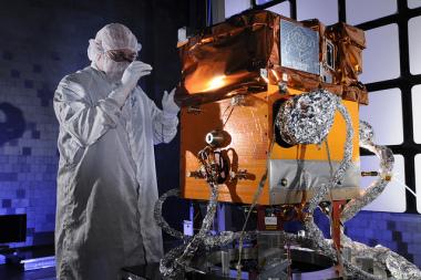 A technician works on STPSat-3 Credit: Ball Aerospace