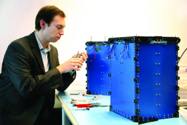 ISIS Chief Executive Jeroen Rotteveel works on QuadPack cubesat deployer. Credit: ISIS