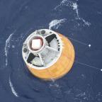 ISRO crew module floating in the Andaman Sea after Dec. 18, 2014 splash down. Credit: ISRO