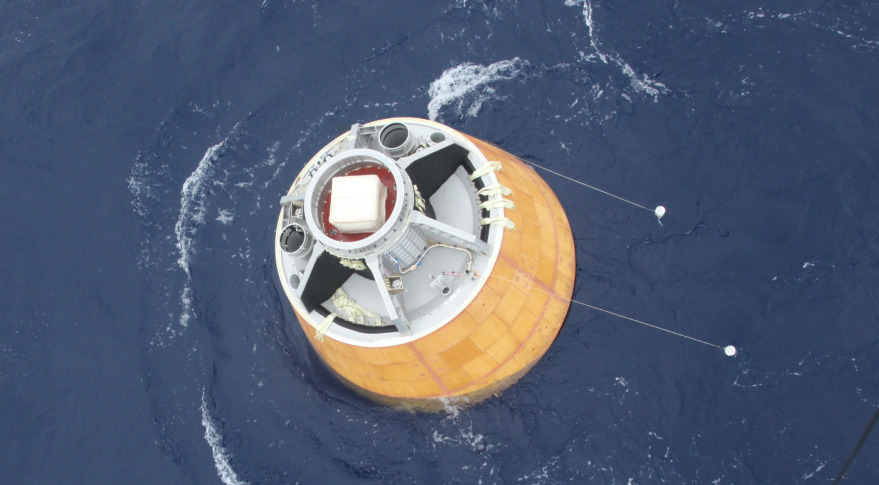 ISRO crew module floating in the Andaman Sea after Dec. 18, 2014 splash down. Credit: ISRO