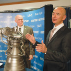 Tony Bruno (left), Jeff Bezos and the BE-4 engine. Credit: SpaceNews/Brian Berger