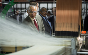 NASA Administrator Charles Bolden inspects a loom at Bally Ribbon Mills facility on Friday, Jan. 9, 2015 in Bally, Pennsylvania. Credit: NASA/Bill Ingalls