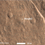 This annotated image shows a bright feature interpreted as the United Kingdom's Beagle 2 Lander with solar arrays at least partially deployed on the surface of Mars. High Resolution Imaging Science Experiment (HiRISE) camera on NASA's Mars Reconnaissance Orbiter have located the lander close to the center of its planned landing area taken Dec. 15, 2014. Credit: NASA/JPL-Caltech/Univ. of Arizona/University of Leicester
