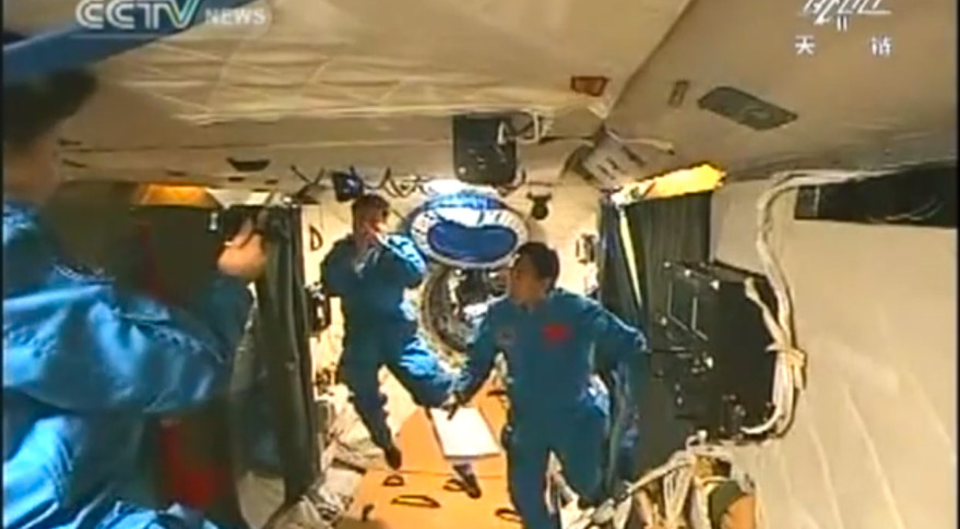 Taikonauts from China's Shenzhou 9 mission onboard Tiangong-1. Credit: China Central Television screen grab