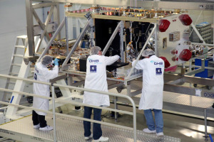 Technicians working on a Galileo satellite. Credit: OHB