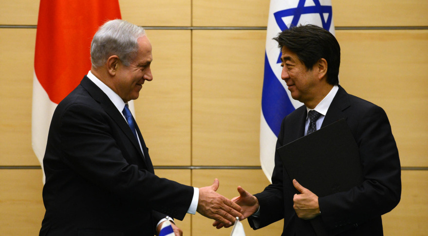 http://spacenews.com/wp-content/uploads/2015/01/NetanyahuandAbe_IsraelGovPressOffice-879x485.jpg