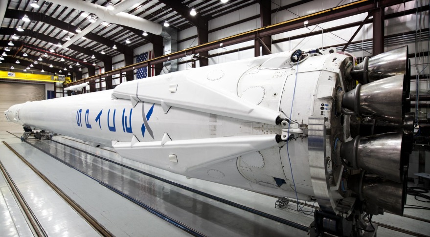 Falcon 9 shown in SpaceX's hangar with landing legs attached in March 2014. Credit: SpaceX