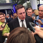 SpaceX CEO Elon Musk amid a reporter scrum following a Dragon in D.C. event at the Newseum last June. Credit: Aaron Mehta via Twitter.