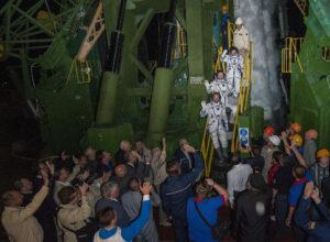 Expedition 41 Soyuz Commander Alexander Samokutyaev of Roscosmos, bottom, Flight Engineer Barry Wilmore of NASA, middle, and Flight Engineer Elena Serova of Roscosmos, top, wave farewell prior to boarding the Soyuz TMA-14M rocket for a Sept. 25, 2014 launch. Credit: NASA/Joel Kowsky