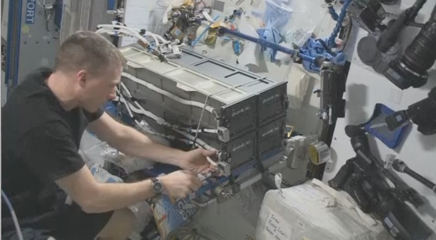 NASA astronaut Terry Virts making the repairs to one of two NanoRacks' cubesat deployers on the ISS. Credit: NASA