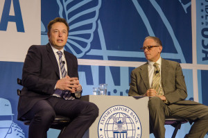 SpaceX Chief Executive Elon Musk (left) and Fred Hochber, chairman and president of the U.S. Export-Import Bank, talk at the bank's April 2014 conference. Credit: U.S. Ex-Im Bank