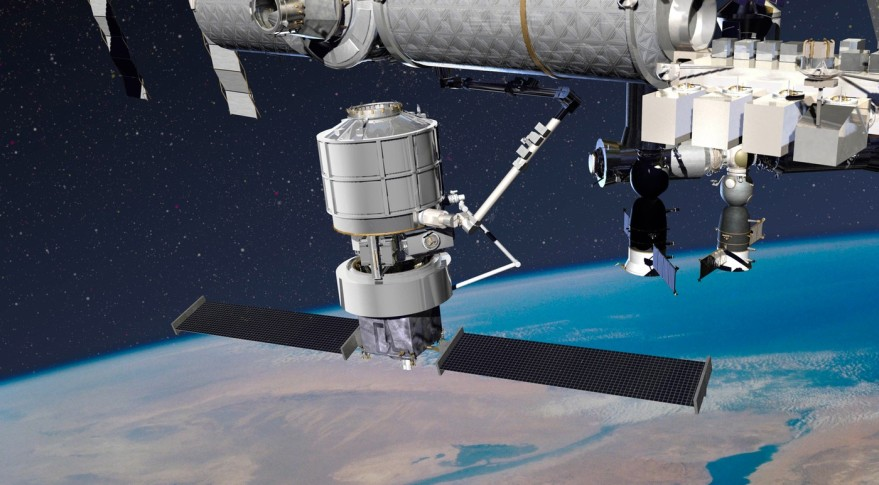 A Lockheed Martin cargo vehicle, consisting of a reusable tug called Jupiter and a cargo module called Exoliner, berths with the International Space Station in this illustration. Credit: Lockheed Martin