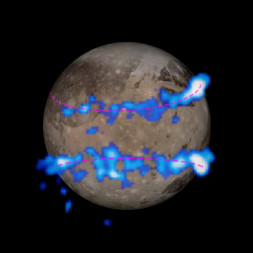 Hubble Space Telescope images of Ganymede's auroral belts (colored blue in this illustration) are overlaid on a Galileo orbiter image of the Jovian moon. The amount of rocking of the moon's magnetic field suggests that it has a subsurface saltwater ocean. Credits: NASA/ESA