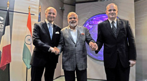 Indian Prime Minister Narendra  Modi (center) with French Foreign Affairs Minister Laurent Fabius (left) and CNES President Jean-Yves Le Gall. Credit: Prime Minister Modi's Office