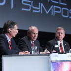 Mark Dankberg (right), Lt. Gen. Mike Hamel, vice president and general manager of commercial space at Lockheed Martin (center). Credit: SpaceNews/Tom Kimmell