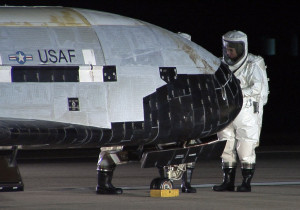 An X-37B undergoes inspection after landing at Vandenberg Air Force Base, California. Credit: USAF