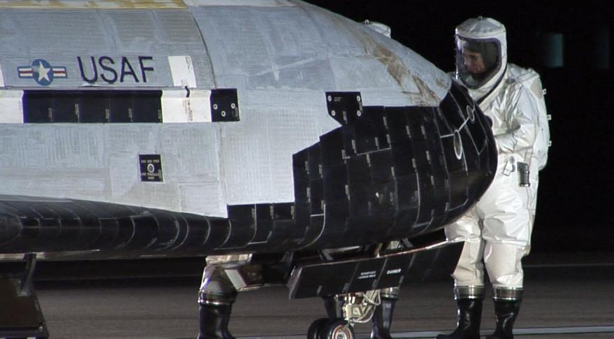 An X-37B undergoes inspection after landing at Vandenberg Air Force Base, California. Credit: USAF