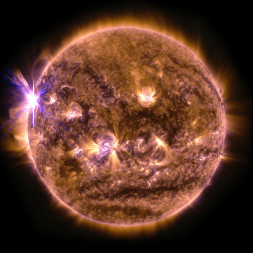 An X2.7 class solar flare flashes on the edge of the sun on May 5, 2015. This image was captured by NASA's Solar Dynamics Observatory and shows a blend of light from the 171 and 131 Ångström wavelengths. Credit: NASA/Goddard Space Flight Center/Solar Dynamics Observatory