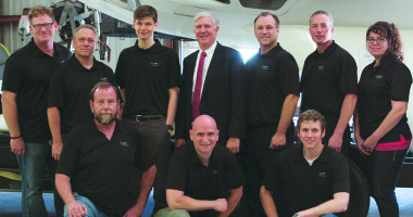 "John Quinn (front row center, with Exos team) said that when Armadillo Aerospace suspended operations, he saw an opportunity: ""This was becoming right at the point of commercial viability, and it stopped.""  Credit: Exos Aerospace photo"