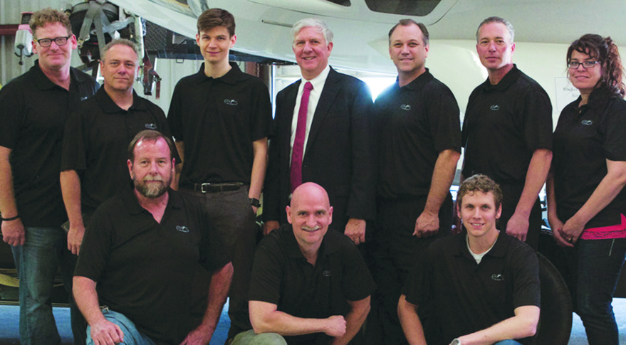 """John Quinn (front row center, with Exos team) said that when Armadillo Aerospace suspended operations, he saw an opportunity: """"This was becoming right at the point of commercial viability, and it stopped.""""  Credit: Exos Aerospace photo"""