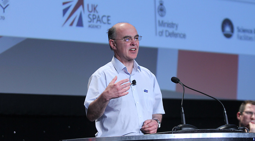 Sir Martin Sweeting, shown speaking at the 31st Space Symposium in April, suggested May 26 that market enthusiasm for small satellites may have gone too far. Credit: Tom Kimmell