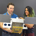 JPL engineers Joel Steinkraus and Farah Alibay display a full-scale mechanical mock-up of a MarCO 6U cubesat. Credit: JPL