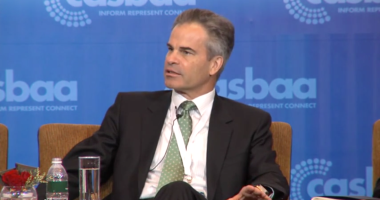William Wade,chief executive of AsiaSat, speaks at CASBAA's Satellite Industry Forum 2014 in Singapore. Credit: CASBAA video