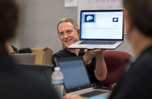 New Horizons Principal Investigator Alan Stern discusses new spacecraft data with fellow team members and embedded July 15, 2015 at the Johns Hopkins University Applied Physics Laboratory (APL) in Laurel, Maryland. Photo Credit: NASA/Bill Ingalls