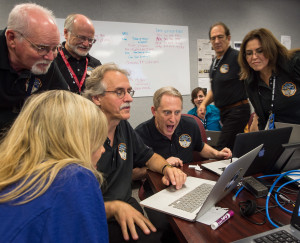 New Horizons Principal Investigator Alan Stern (center) reacts to the first images from the probe's July 14 Pluto flyby. Credit: NASA