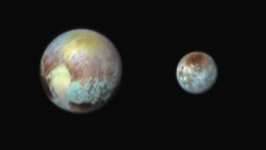 Pluto and Charon is presented in false colors to make differences in surface material and features easy to see. Credit: NASA, APL, SwRI
