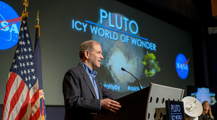 John Grunsfeld speaking at a July 24 conference about recent Pluto discoveries. Credit: NASA