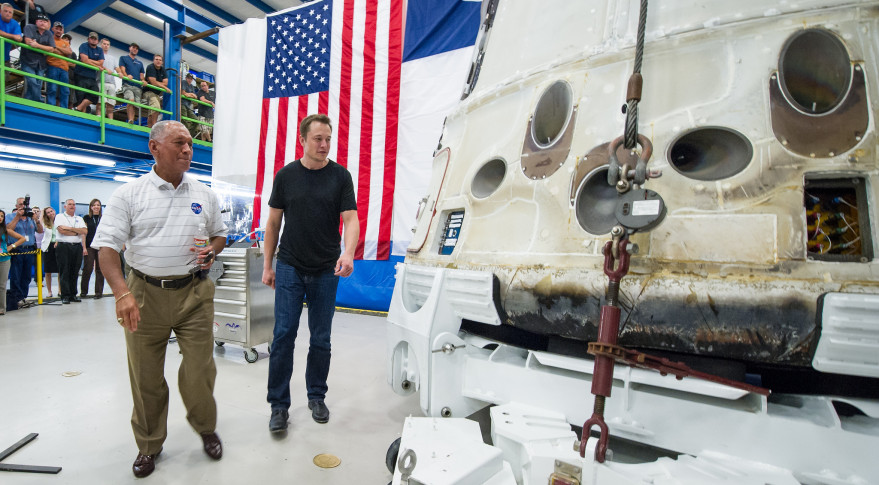elon musk and nasa administrator charles bolden inspect the dragon capsule after it had returned from