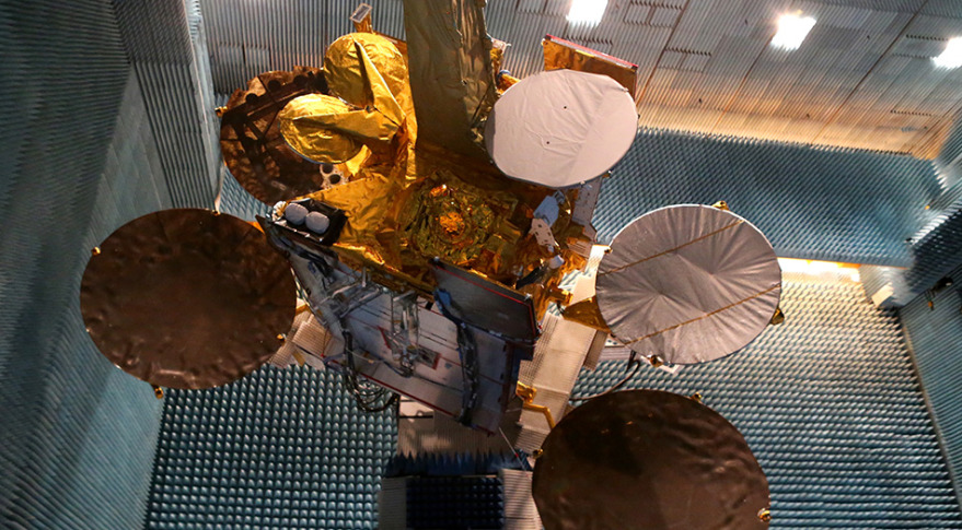 The Eutelsat 9B satellite with its EDRS-A payload is shown in the anechoic test chamber of Airbus Defence and Space in Toulouse, France. Credit: Airbus Defence and Space