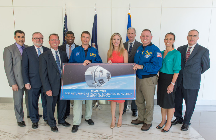 """NASA astronauts Reid Wiseman, front left, and Barry """"Butch"""" Wilmore thanked senior leaders from Boeing for continued work on the Boeing CST-100 spacecraft  during a June 2 ,visit to Boeing offices in Arlington, Virginia. NASA plans to use  spacecraft privately developed and operated by Boeing and SpaceX to carry as many as four astronauts per mission to the ISS. (NASA/Joel Kowsky)"""