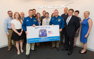"NASA astronauts Reid Wiseman and Barry ""Butch"" Wilmore met with senior leaders of the SpaceX during a June 24 visit to SpaceX's Washington offices. (NASA/Joel Kowsky)"