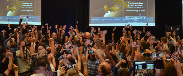 The moment of the New Horizons flyby of Pluto is celebrated at APL. Credit: SpaceNews/Jonathan Charlton