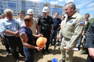 Dmitry Rogozin, the deputy prime minister of Russia who oversees the country's space sector, listens to construction workers during a July 2 visit to Vostochny Cosmodrome. Credit: The Military-Industrial Commission of Russia