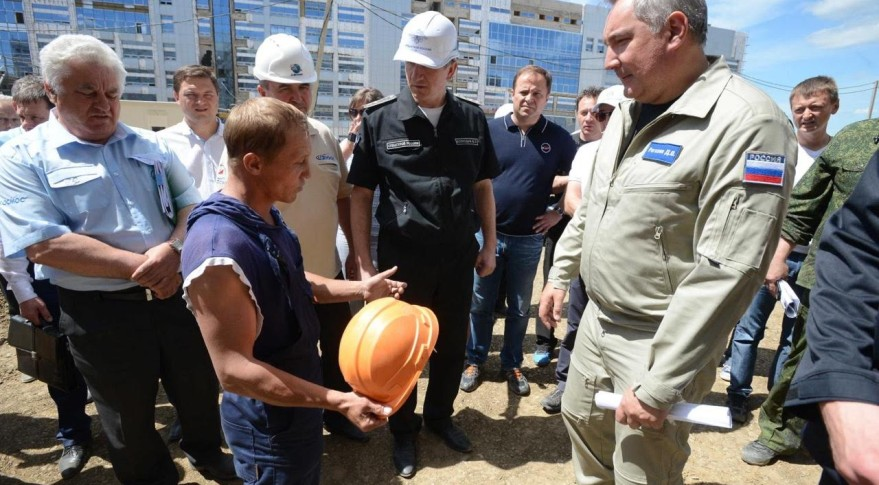 Dmitry Rogozin oversaw deputy prime minister of Russia who oversees the country's space sector, listens to construction workers during a July 2 visit to Vostochny Cosmodrome. Credit: The Military-Industrial Commission of Russia
