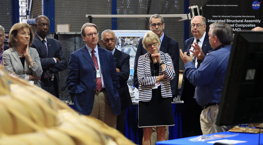 Members of the NASA Advisory Council and NASA Administrator Charles Bolden (fourth from the left) visit Langley Research Center in July 2014. Credit: NASA/David C. Bowman