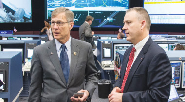 Rep. Brian Babin (left) discusses the International Space Station with ISS Flight Director Norm Knight. Credit: NASA Photo