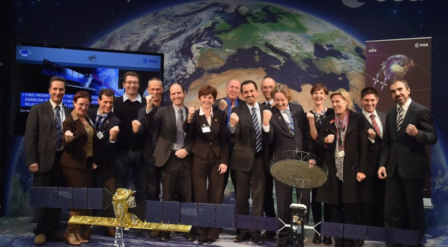 European space officials pose in with models of the AlphaSat and Sentinel-1A satellites in November 2014 at an event marking the start of laser-link testing. Credit: ESA/J.Mai