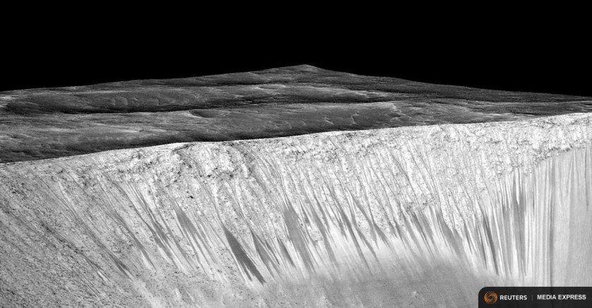 Dark narrow streaks called recurring slope lineae emanating out of the walls of Garni crater on Mars are seen in an image produced by NASA, Jet Propulsion Laboratory (JPL) and the University of Arizona. NASA/JPL/University of Arizona/Handout