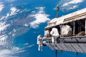 Astronauts work outside the International Space Station. Photo: NASA