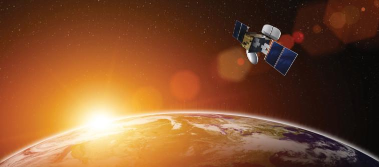 Artist's Conception of a Broadband satellite over Earth. Credit: Criccieth TV