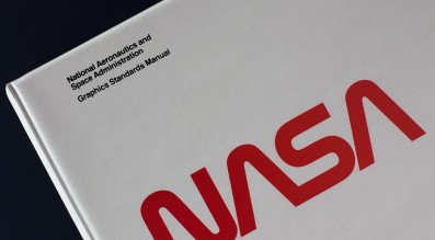 The cover of the original NASA Manual, an 8.5 x 11 ring bound folder.
